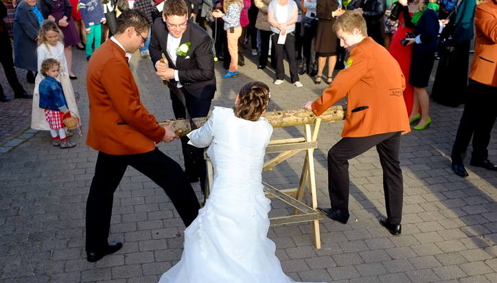 Bride and Groom Sawing a Log