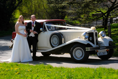 Couple with the Wedding Car