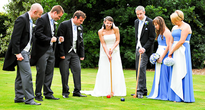 Wedding Couple playing croquet